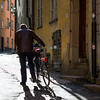 Man walking with bicycle in street, Gamla Stan, Stockholm, Sweden