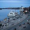 Passenger boat at harbor with Fotografiska - the Swedish Museum of Photography in background, Saltsjon, Stockholm, Sweden