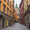 City street with Stockholm Cathedral in the background, Gamla Stan, Stockholm, Sweden