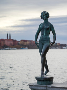 Statue of naked woman near embankment of City Hall, Stockholm, Sweden