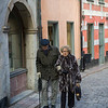 Elderly couple walking in street, Gamla Stan, Stockholm, Sweden