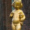 Close-up of golden statue of girl with flower, Stockholm, Sweden