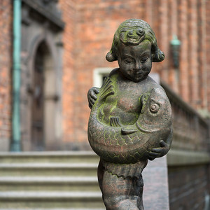 Close-up statue of boy with a fish, Stockholm, Sweden