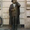 Statue of Evert Taube, a Swedish author, artist, composer and singer, Jarntorget, Gamla Stan, Stockholm, Sweden