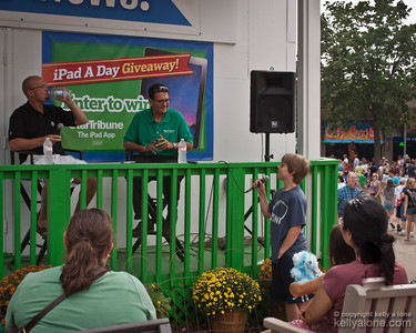 """Yeo handles some tough questions from the audience. Michael Russo of the Star Tribune talks Minnesota Wild hockey with rookie coach Mike Yeo at the Star Tribune """"Porch"""" booth."""