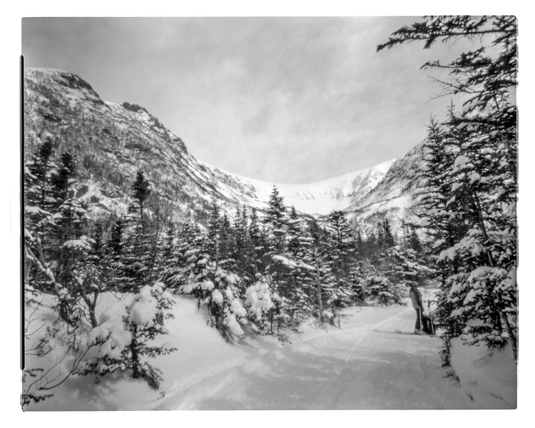 The Pinhole Project                           Location : Mont Washington, N.H., Tuckerman ravine. Camera : Ilford  Herman Pinhole camera, B&W film. I wanted to experience pinhole photo, a really slow process, with an action sport, skiing.  I went for a one week trip with ten sheets of film to capture the skiing done in the Tuckerman. With an aperture of approximately f/213, you have to get creative in order to make rich and inspiring pictures. The result are realy unique. Landscape photo of Tuckerman Ravine