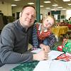Cedric with Son Gael Richard work on Santa cards at the Hampton PTA Santa Breakfast and Food Drive @ Hampton Academy on Saturday 12-12-2015, Hampton, NH.  Matt Parker Photos