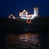 Nubble Light House is lit at the York Days Celebration, Christmas in July on Sunday @ Nubble Lighthouse, York Beach, ME on 7-26-2015.  Matt Parker Photos