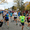 Runners head down the first hill after the start of the 2016 Seacoast Half Marathon on Sunday 11-13-2016 @ Portsmouth, NH.  Matt Parker Photos