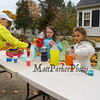 A couple of young Portsmouth residents Sabina and Kierstien serve up energy drinks to the runners prior to the start of the 2016 Seacoast Half Marathon on Sunday 11-13-2016 @ Portsmouth, NH.  Matt Parker Photos