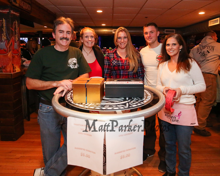 Members of the Hampton Fire Department (L to R) Matt Cray, Kate Meehan, Karissa Kerouac, Alex Holmes and Darian Millet pose for a photo at the entrance to Wally's Pub where tickets were sold to raise money for the Hampton Fire Fighter Toy Bank and Chili Cook-off Fundraiser on Thursday 11-17-2016 @ Wally's Pub, Hampton Beach, NH.  Matt Parker Photos