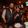"""Rob McCarron of Jim Beam and Mary Shaw of, """"Me & D's Diner"""" of Well's ME pose for a photo at the Hampton Fire Fighter Toy Bank and Chili Cook-off Fundraiser on Thursday 11-17-2016 @ Wally's Pub, Hampton Beach, NH.  Matt Parker Photos"""