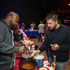 """Jason Miles serves some of his, """"Sweet Angus Beef"""" chili to a customer at the Hampton Fire Fighter Toy Bank and Chili Cook-off Fundraiser on Thursday 11-17-2016 @ Wally's Pub, Hampton Beach, NH.  Matt Parker Photos"""
