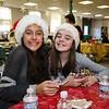 Hampton Academy 7th Graders Emma Abdelhamid (L) and Brooke Riouxat share their photos of the Annual PTA Breakfast with Santa on Saturday @ Hampton Academy on 12-10-2016.  Matt Parker Photos