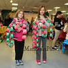 Sisters Moxie (3rd grade) and Maitri Clifford (4th) pose for a photo with their paper chains at the Annual Hampton PTA Breakfast with Santa on Saturday @ Hampton Academy on 12-10-2016.  Matt Parker Photos
