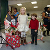 Kindergartener Noelle Macdonald with brother Thomas (preschool) waits in line to have their picture take with Santa at the Annual Hampton PTA Breakfast with Santa on Saturday @ Hampton Academy on 12-10-2016.  Matt Parker Photos