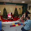 Photographer Mike McMahon volunteered his time to take photos of the kids with santa as parents look on at the Annual Hampton PTA Breakfast with Santa on Saturday @ Hampton Academy on 12-10-2016.  Matt Parker Photos