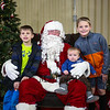 2nd grader Cooper Westergren with brothers Tanner (7 months) and older brother 4th grader Reid pose for a photo with Santa at the Annual Hampton PTA Breakfast with Santa on Saturday @ Hampton Academy on 12-10-2016.  Matt Parker Photos