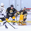 Bruins Alumni Goalie #35 Cleon Daskalakis deflects a shot by Team Richie #22 Dave Branning with Bruins #77 Ray Bourque defending at the Richie McFarland Children's Center Charity Hockey event between the Boston Bruins Alumni vs Team Richie on Saturday 12-17-2016 @ The Rinks at Exeter.  Matt Parker Photos