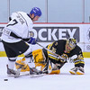 Bruins Alumni Goalie #35 Cleon Daskalakis makes a save by charging the puck controlled by Team Richie #7 Kenny Craig at the Richie McFarland Children's Center Charity Hockey event between the Boston Bruins Alumni vs Team Richie on Saturday 12-17-2016 @ The Rinks at Exeter.  Matt Parker Photos