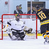 Team Richie Goalie #30 Darren Finniss takes a shot off his jersey by Bruins Alumni #10 Kenny Hodge at the Richie McFarland Children's Center Charity Hockey event between the Boston Bruins Alumni vs Team Richie on Saturday 12-17-2016 @ The Rinks at Exeter.  Matt Parker Photos