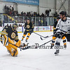 Bruins Alumni Goalie #35 Cleon Daskalakis makes a save off a shot by Team Richie #15 Brett Hemingway with his borrowed stick after his goalie stick broke on a previous save at the Richie McFarland Children's Center Charity Hockey event between the Boston Bruins Alumni vs Team Richie on Saturday 12-17-2016 @ The Rinks at Exeter.  Matt Parker Photos