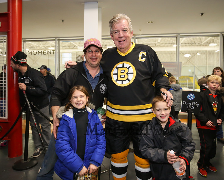 Bruins Alumni #24 Terry O'Reilly pose for a photo with Tim Carnes of Ossipee with his children Oliviana, 3rd grade and Cam, 2nd grade at the Richie McFarland Children's Center Charity Hockey event between the Boston Bruins Alumni vs Team Richie on Saturday 12-17-2016 @ The Rinks at Exeter.  Matt Parker Photos