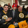 Cole Kelley of Brentwood poses for a photo with Bruins Alumni #27 Mike Mottau and Goal Keeper #35 Cleon Daskalakis during half-time at the Richie McFarland Children's Center Charity Hockey event between the Boston Bruins Alumni vs Team Richie on Saturday 12-17-2016 @ The Rinks at Exeter.  Matt Parker Photos