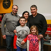 Bruins Alumni #77 Ray Bourque poses for a photo with Richie McFarland Events Coordinator Jessica Carbonneau and her family during the after party at Shootes Pub in Exeter after the Richie McFarland Children's Center Charity Hockey event between the Boston Bruins Alumni vs Team Richie on Saturday 12-17-2016 @ The Rinks at Exeter.  Matt Parker Photos
