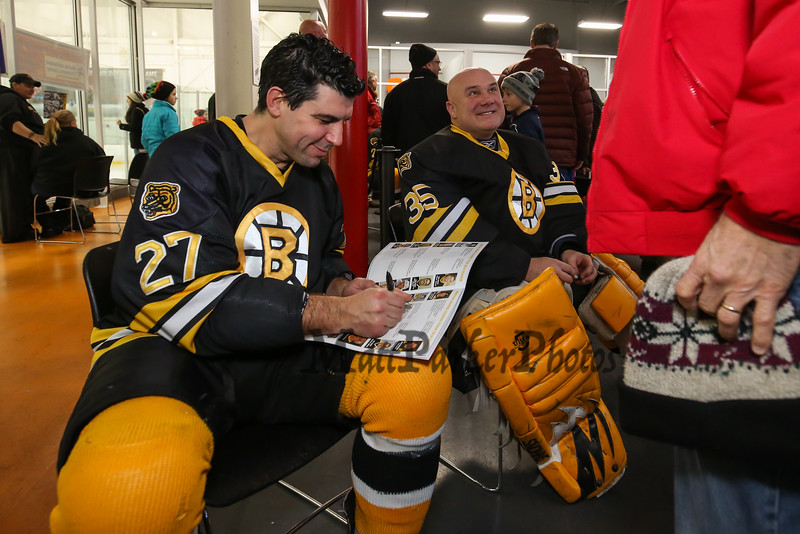 Bruins Alumni #27 Mike Mottau and Goal Keeper #35 Cleon Daskalakis sign autographs during half-time at the Richie McFarland Children's Center Charity Hockey event between the Boston Bruins Alumni vs Team Richie on Saturday 12-17-2016 @ The Rinks at Exeter.  Matt Parker Photos