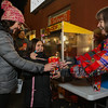 Emma and Evie MacDonald are handed fresh popcorn by Pat Walker.  The popcorn table was sponsored by The Friends of the Library and the Hampton Fire Fighters at the 2016 Annual Christmas Tree Lighting at the Gazebo at Marelli Square sponsored by the Hampton Parks & Recreation Department on Friday Night, Hampton, NH, 12-2-2016.  Matt Parker Photos