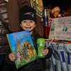 """5 year old Lennix Ruggiero picks, """"The Golden Christmas Tree"""" book from the Hampton Library free book night at the 2016 Annual Christmas Tree Lighting at the Gazebo at Marelli Square sponsored by the Hampton Parks & Recreation Department on Friday Night, Hampton, NH, 12-2-2016.  Matt Parker Photos"""