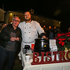 Experience Hampton Board of Director George Prive (L) poses for a photo with Chef Aaron Duvall of Chez Boucher at the 2016 Annual Christmas Tree Lighting at the Gazebo at Marelli Square sponsored by the Hampton Parks & Recreation Department on Friday Night, Hampton, NH, 12-2-2016.  Matt Parker Photos