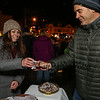 Kellan Maloney of the Galley Hatch hands Chris Valhouli a cup of hot chocolate at the 2016 Annual Christmas Tree Lighting at the Gazebo at Marelli Square sponsored by the Hampton Parks & Recreation Department on Friday Night, Hampton, NH, 12-2-2016.  Matt Parker Photos