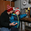 Carter Mattison's eyes go wide after flipping the swith to light the Christmas tree with his Dad, Hampton Fire Fighter Brandon Mattison at the 2016 Annual Christmas Tree Lighting at the Gazebo at Marelli Square sponsored by the Hampton Parks & Recreation Department on Friday Night, Hampton, NH, 12-2-2016.  Matt Parker Photos