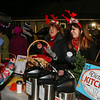 Kelly Eaton and Victoria's Kitchen owner Tracey Dewhurst (R) serve up hot chocolate at the 2016 Annual Christmas Tree Lighting at the Gazebo at Marelli Square sponsored by the Hampton Parks & Recreation Department on Friday Night, Hampton, NH, 12-2-2016.  Matt Parker Photos