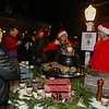 Lisa Keene and Rizzo of the Old Salt serve up clam chowder at the 2016 Annual Christmas Tree Lighting at the Gazebo at Marelli Square sponsored by the Hampton Parks & Recreation Department on Friday Night, Hampton, NH, 12-2-2016.  Matt Parker Photos