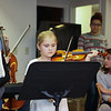 "Marston 3rd grader Morgan Hoyt on the violin while playing ""Eagles Pride"" with others at Friday's Christmas Holiday Concert and Performance for the residents of Dearborn House by music and voice students from the area schools of Centre School, Marston School, Hampton Academy and Winnacunnet High School on 12-9-2016 @ Dearborn House, Hampton, NH.  Matt Parker Photos"