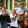 """Eagles Pride"" was played by Marston School 4th grader Maddie Hoyt (violin), sister, 3rd grader, Morgan (violin), Winnacunnet Junior Brian Coffen (chello) and Stephen Porier (violin) (just out of the frame) at Friday's Christmas Holiday Concert and Performance for the residents of Dearborn House by music and voice students from the area schools of Centre School, Marston School, Hampton Academy and Winnacunnet High School on 12-9-2016 @ Dearborn House, Hampton, NH.  Matt Parker Photos"