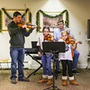 """Eagles Pride"" was played by (L to R) Stephen Porier (violin), Marston School 4th grader Maddie Hoyt (violin), Winnacunnet Junior Brian Coffen (chello), and Marston 3rd grader Morgan Hoyt (violin) at Friday's Christmas Holiday Concert and Performance for the residents of Dearborn House by music and voice students from the area schools of Centre School, Marston School, Hampton Academy and Winnacunnet High School on 12-9-2016 @ Dearborn House, Hampton, NH.  Matt Parker Photos"