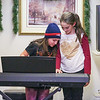 Marston School 3rd grader Ava Malony and 5th grader Grace Rhode play the piano at Friday's Christmas Holiday Concert and Performance for the residents of Dearborn House by music and voice students from the area schools of Centre School, Marston School, Hampton Academy and Winnacunnet High School on 12-9-2016 @ Dearborn House, Hampton, NH.  Matt Parker Photos