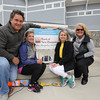 (L to R) Dan Raposa and Kathy kerrigan of Exeter Hospital with Carrie Shaw, sister of Ann-Marie Viviano, recognize Wendy Rayno and Bank of NH as a Platinum Level Sponsor at the Beyond the Rainbow Kites Against Cancer benefit for Exeter Hospital's Beyond the Rainbow Fund on a windy Sunday 5-15-2015 @ Hampton Beach Seashell stage, Hampton Beach, NH.  Matt Parker Photos