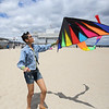 8th grader Seada Ross of Amesbury MA launches her kite  at Sunday's Kites Against Cancer benefit for Exeter Hospital's Beyond the Rainbow Fund at a windy Hampton Beach on 5-15-2016.  Matt Parker Photos
