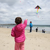 Eliza Paradis of Stratham gets her kite in the air with the help of Sue Saucier assisting at the Kites Against Cancer benefit for Exeter Hospital's Beyond the Rainbow Fund on a windy Sunday 5-15-2015 @ Hampton Beach Seashell stage, Hampton Beach, NH.  Photo courtsey of Kris Wirth