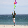 A boy launches his kite at Sunday's Kites Against Cancer benefit for Exeter Hospital's Beyond the Rainbow Fund at a windy Hampton Beach on 5-15-2016.  Matt Parker Photos