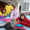 Volunteers Maureen Callahan and Bob Janukowics of Stratham assits Vicky Turgeon of Epping and Kayden Ranfos of Newmarket with their kite decorations at the Kites Against Cancer benefit for Exeter Hospital's Beyond the Rainbow Fund on a windy Sunday 5-15-2015 @ Hampton Beach Seashell stage, Hampton Beach, NH.  Matt Parker Photos