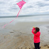 Cassie Wirth flies her kite out over the Atlantic at the Kites Against Cancer benefit for Exeter Hospital's Beyond the Rainbow Fund on a windy Sunday 5-15-2015 @ Hampton Beach Seashell stage, Hampton Beach, NH.  Photo courtsey of Kris Wirth