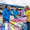 Walter Johnson of Worcester MA and Sue Saucier of Millbury MA purchase Kites at the Kites Against Cancer benefit for Exeter Hospital's Beyond the Rainbow Fund on a windy Sunday 5-15-2015 @ Hampton Beach Seashell stage, Hampton Beach, NH.  Matt Parker Photos