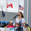 """8th Grader Grace Castonguay of Oyster River Middle School sings, """"Somewhere Over the Rainbow"""" while playing the Ukulele at the opening ceremony at the Kites Against Cancer benefit for Exeter Hospital's Beyond the Rainbow Fund on a windy Sunday 5-15-2015 @ Hampton Beach Seashell stage, Hampton Beach, NH.  Matt Parker Photos"""