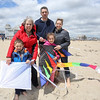 Ed and Erica Paradis with children Graham (front) and Eliza with their Grandmother Ann Parnell of Stratham pose for a photo on a windy beach at the Kites Against Cancer benefit for Exeter Hospital's Beyond the Rainbow Fund on a windy Sunday 5-15-2015 @ Hampton Beach Seashell stage, Hampton Beach, NH.  Photo courtsey of Kris Wirth